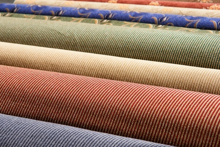 fabric roll: Rolled up carpets