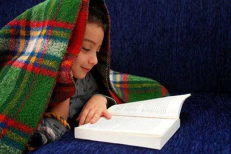 Boy reads book under blanket Stock Photo - 9726793