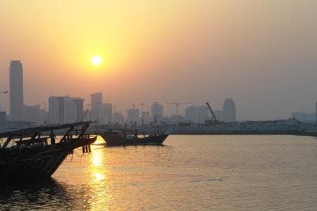 bahrain money: Bahrain cityscape - sunset scene
