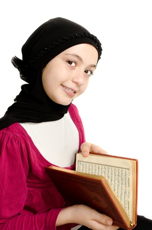 arab hijab: Little girl reads the holy Koran - Isolated on white background