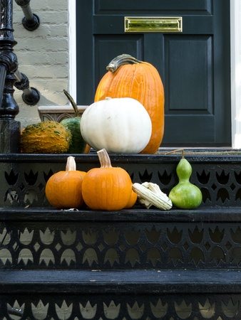 Halloween ready house patio with colorful pumpkins photo