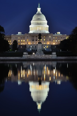 Washington DC, Capitol Building with reflection on pool at night photo