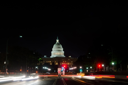Washington DC, Capitol at night with city lights and car lights trails