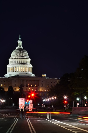 Washington DC, Capitol at night with city lights and car lights trails photo