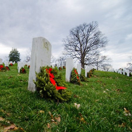 bury: Headstones in Christmas time in Arlington National Cemetery - Washington DC United States  Stock Photo