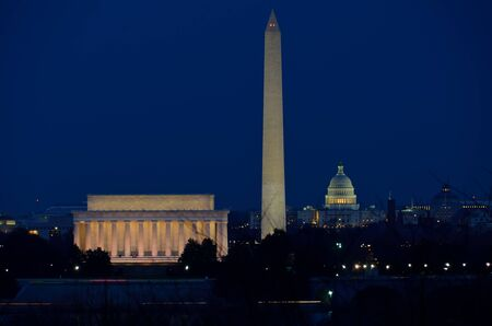 election night: Washington DC city view in sunrise, including Lincoln Memorial, Monument and Capitol building  Stock Photo