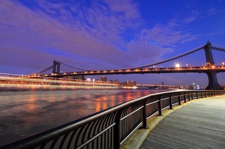 new day: New York City, Manhattan Bridge at night - United States