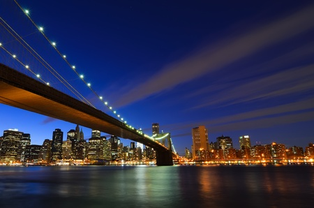 New York City, Brooklyn Bridge and lower Manhattan at night  Stock Photo