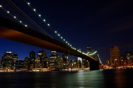 New York City, Brooklyn Bridge and lower Manhattan at night
