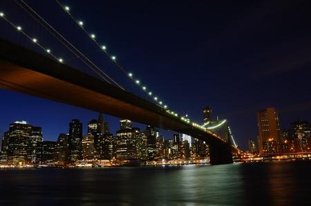 New York City, Brooklyn Bridge and lower Manhattan at night  Stock Photo