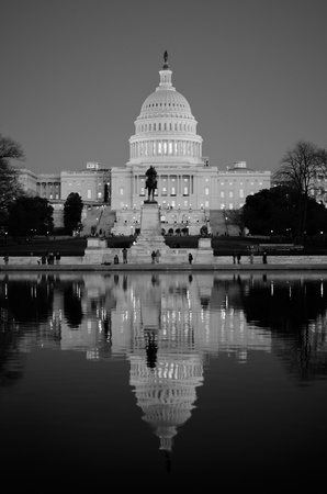 election night: Washington DC - United States Capitol building and its reflection on pool at sunrise - Black and white Stock Photo