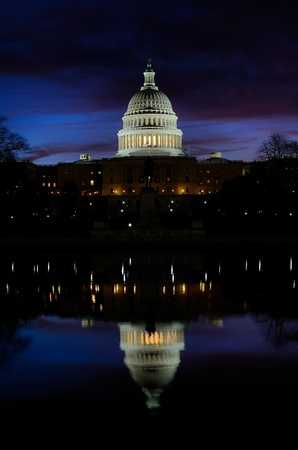 election night: Washington DC - United States Capitol building and mirror reflection on pool at sunrise