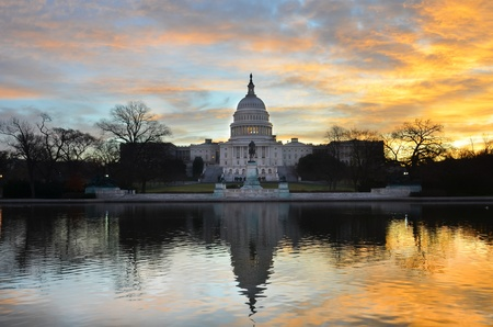 Washington DC - United States Capitol building and its reflection on pool at sunrise  photo