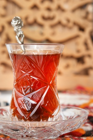 Turkish tea in traditional glass with oriental background  photo