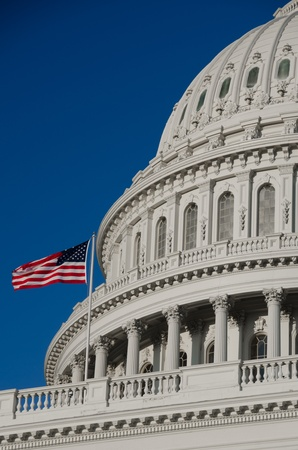 neoclassical: Washington DC, US Capitol building dome detail with waving US flag - United States