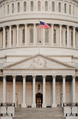 federal: Washington DC, US Capitol building dome detail with waving US flag - United States