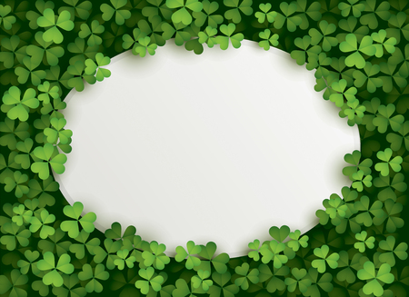 A oval shape blank card surrounded in a patch of clovers.