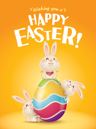 Happy Easter! Easter bunnies and egg in plain background. Wide copy space for text. Reklamní fotografie - 124994317