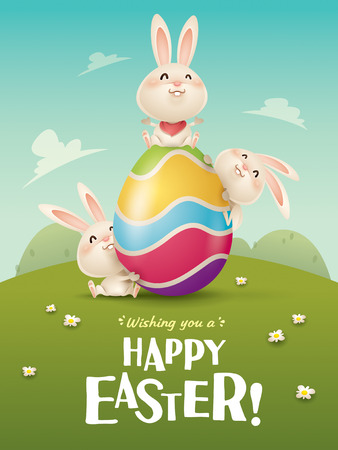 Happy Easter! Easter bunnies and egg in field. Wide copy space for text. Imagens - 124994319