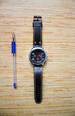 Wrist watch with writing pen