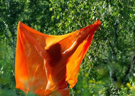 beautiful girl standing behind with orange shawl photo