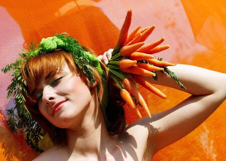 stil: Woman holding bunch of carrots Stock Photo
