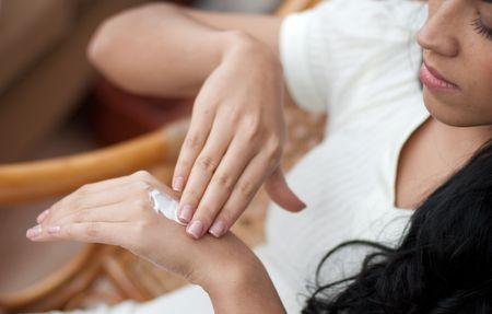 Female applying cream to her hands Stock Photo - 6097230