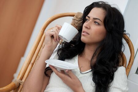 Beautiful girl drinking coffee photo
