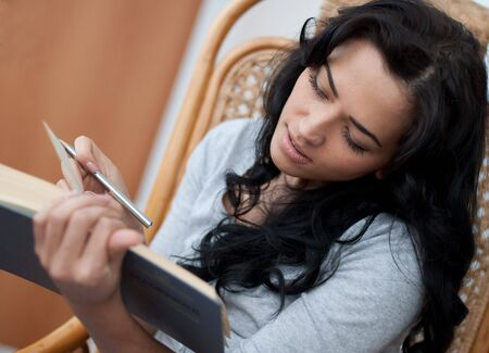 Beautiful girl reading the book photo
