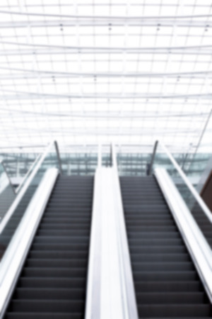 overexposed: escalator in very bright office building as an image background texture blurred