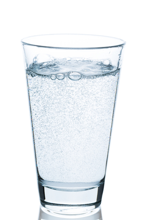 bubbling: Glass of water bubbling on white background