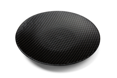 elevated view: Elevated view of a black textured plate isolated on white background.