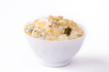 Potato Salad in white bowl on white plain background. Standard-Bild