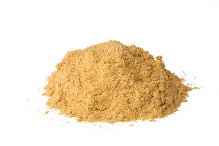 Heap of ginger powder isolated on white background, closeup. Stockfoto