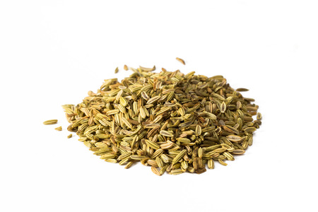 foeniculum: Heap of fennel seed isolated on white background, closeup.