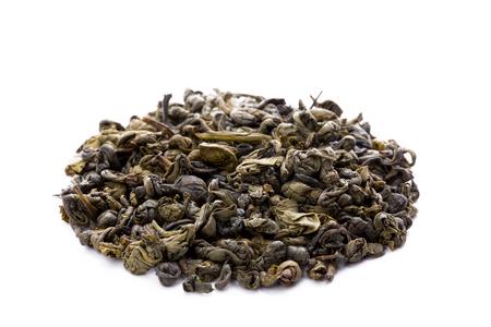 gunpowder: Heap of leaves of green chinese gunpowder tea, closeup, frontview,  isolated on white background.