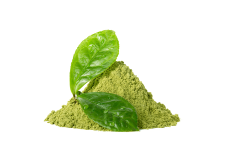 Green matcha tea powder with two green wet leaves with waterdrops isolated on white background