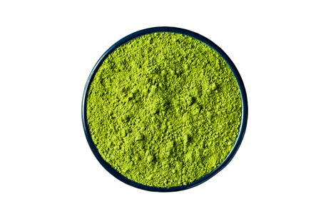 sencha: Ground matcha green tea powder in a round cast iron cup, isolated on white background, clipping path included, view from above. Stock Photo