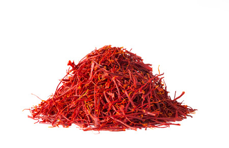 Heap of saffron threads, autumn crocus, isolated on white background Stock Photo