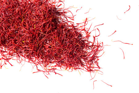 saffron crocus threads on isolated white background, view from above, flatlay Stock Photo