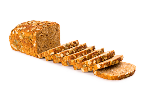 Wholemeal granary bread partly sliced isolated on white background, front view, closeup