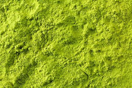 Green matcha tea powder full frame flat lay as image background