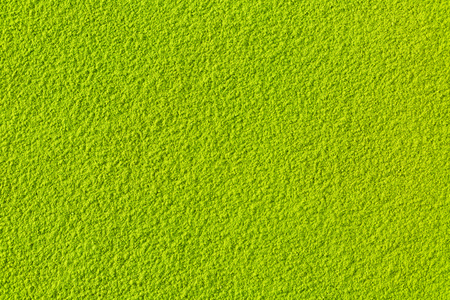 Green matcha tea powder full frame flat lay as image background