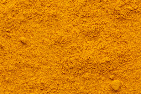 Curry powder ground full frame image background with rough surface, view directly from above.