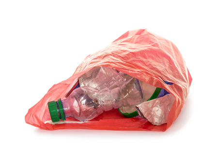Red plastic garbage bag with stick out empty plastic bottle and other rubbish isolated on white background
