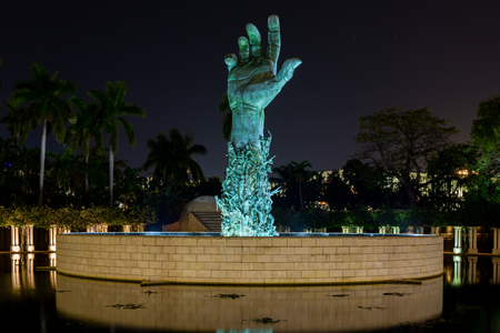 Miami Beach, Florida, USA - January 5th, 2019, The Holocaust Memorial. The memorial consists of several elements. The focal point is the 13 meter (42 feet) high bronze sculpture The Sculpture of Love and Anguish. The forearm is modeled from about 100 peop