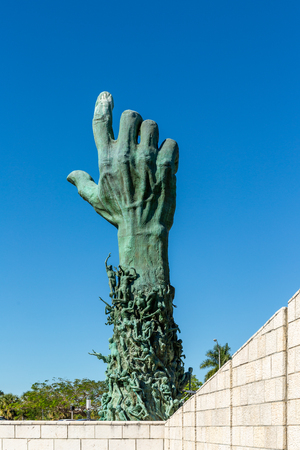 Miami Beach, Florida, USA - January 10th, 2019, The Holocaust Memorial. The memorial consists of several elements. The focal point is the 13 meter (42 feet) high bronze sculpture The Sculpture of Love and Anguish. The forearm is modeled from about 100 peo Editorial