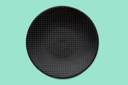 Black plate on mint green colored background, clipping path included, view directly from above