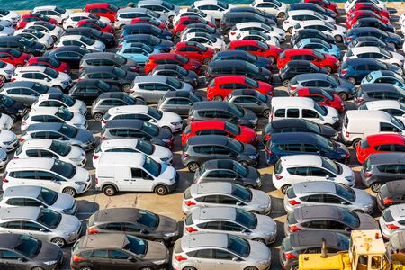 Barcelona, Spain - July 8th 2018 , Cars ready for shipping and export and the harbour of Barcelona