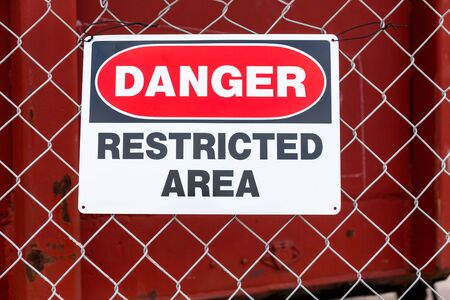Danger, Restricted Area Sign on wire mesh fence